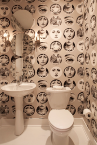 Andy Warhol pop art inspired residence.  Portraits show a new face to this wall.
