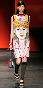 Prada uses oversized portraits  openly crediting the six artists who painted the portraits, a rarity in the apparel industry which exemplifies just how important the artist is to this trend.