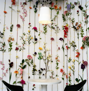 A lovely idea, silk flowers illusively taped to the wall create your own in-home green-house (without the need to water)