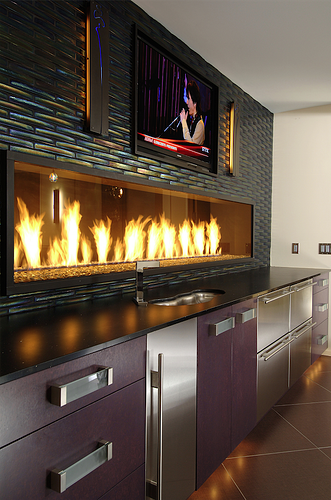 "Glitz and glam make this bar top fireplace a big WOW factor for this home. Shown here 1.25"" x 10"" Extrados in Rainbow."