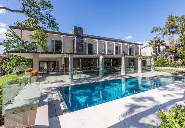 MUPool42-Industrial-modern-backyard-design-glass-tile-waterline-pool